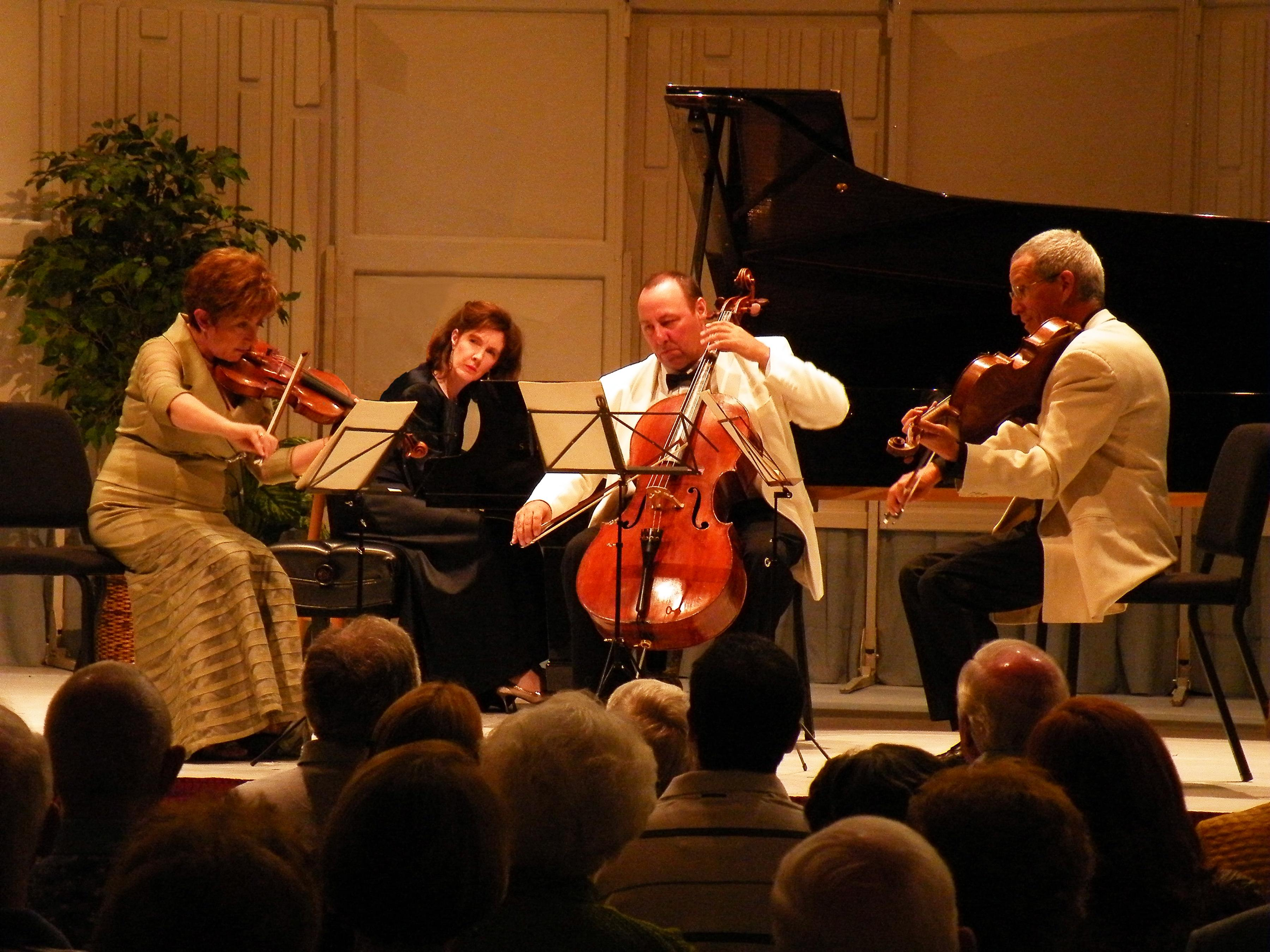 A quartet performing together.